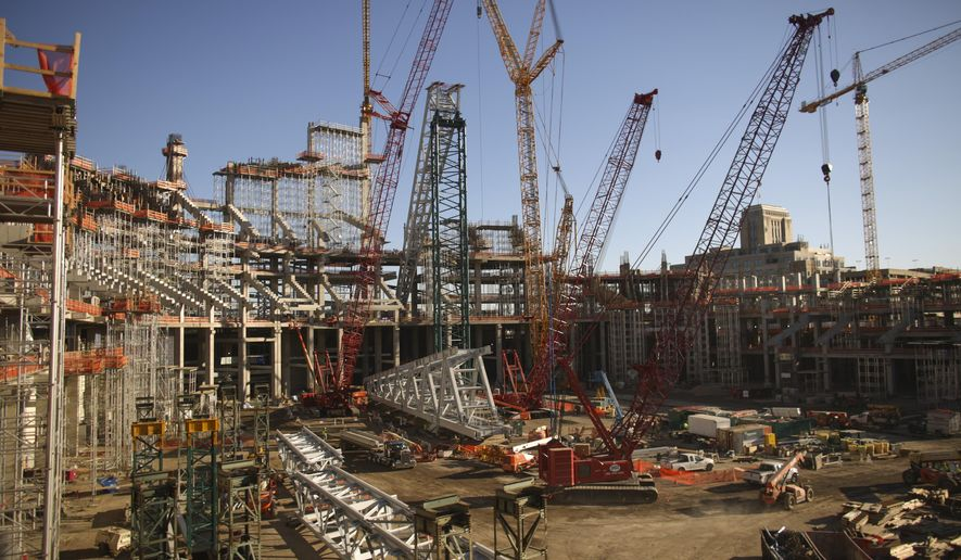 An overall view of the construction progress on the interior of the new Vikings stadium Monday, Oct. 20, 2014.  Nine months after the old Metrodome was demolished, officials say the new stadium is 23 percent complete as of the end of September. (AP Photo/The Star Tribune, Jeff Wheeler)