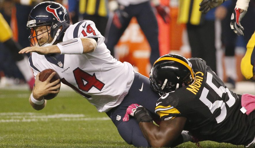 Houston Texans quarterback Ryan Fitzpatrick (14) is tackled by Pittsburgh Steelers outside linebacker Arthur Moats (55)in the first half of the NFL football game, Monday, Oct. 20, 2014 in Pittsburgh. (AP Photo/Gene J. Puskar)