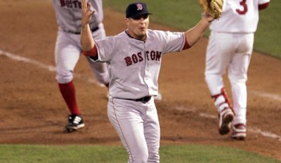 Boston Red Sox pitcher Keith Foulke, center, and first baseman Doug Mientkiewicz, left, celebrate after St. Louis Cardinals' Edgar Renteria (3) grounded out to end the ninth inning and give Boston a 3-0 win and a sweep of the World Series, Wednesday Oct. 27, 2004, in St. Louis. (AP Photo/Mark Humphrey)