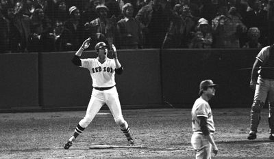 FILE - In this Oct. 22, 1975, file photo, Boston Red Sox's Carlton Fisk, left, watches his 12th-inning home run against the Cincinnati Reds to win the sixth game of the World Series at Fenway Park in Boston. (AP Photo/Harry Cabluck, File)