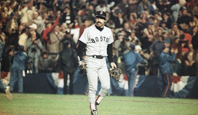 Boston Red Sox first baseman Bill Buckner is a picture of dejection as he leaves the field after committing an error on a ball hit by New York Mets Mookie Wilson which allowed the winning run to score in the sixth game of the World Series, Saturday night, Oct. 25, 1986 in New York.  (AP Photo/Rusty Kennedy)