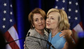 Former Secretary of State Hillary Rodham Clinton, right, is embraced by House Minority Leader Nancy Pelosi, left, before speaking at a fundraiser for Democratic congressional candidates hosted by Pelosi at the Fairmont Hotel, Monday, Oct. 20, 2014, in San Francisco. (AP Photo/Eric Risberg) ** FILE **