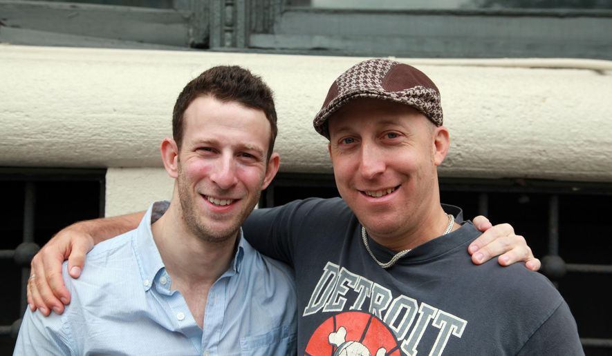 """In this Oct. 10, 2014 photo, actor Nick Blaemire, left, and magazine publisher Davy Rothbart pose in downtown New York. Blaemire plays Rothbart in a semi-fictionalized musical account of the creation of the magazine """"Found,"""" which collects misdirected or discarded notes. (AP Photo/Mark Kennedy)"""