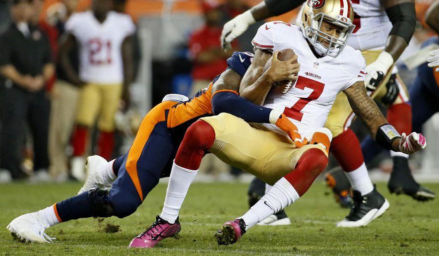 Denver Broncos outside linebacker Von Miller, rear, tackles San Francisco 49ers quarterback Colin Kaepernick (7) during the second half of an NFL football game, Sunday, Oct. 19, 2014, in Denver. (AP Photo/Jack Dempsey)