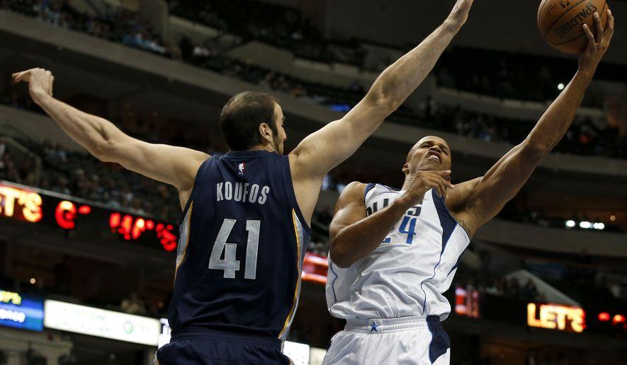 Memphis Grizzlies' Kosta Koufos (41) defends as Dallas Mavericks forward Richard Jefferson goes up for a shot in the first half of a preseason NBA basketball game, Monday, Oct. 20, 2014, in Dallas. (AP Photo/Tony Gutierrez)