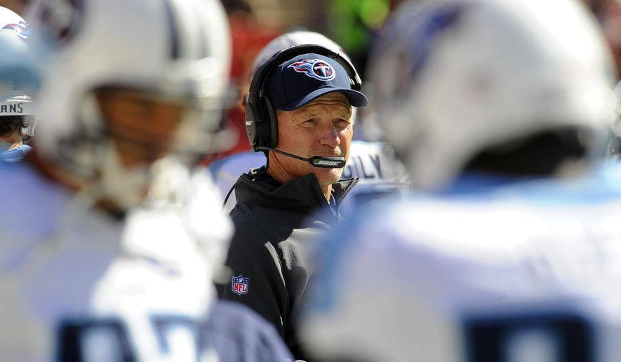 Tennessee Titans head coach Ken Whisenhunt stands on the field before an NFL football game against the Washington Redskins, Sunday, Oct. 19, 2014, in Landover, Md. (AP Photo/Richard Lipski)