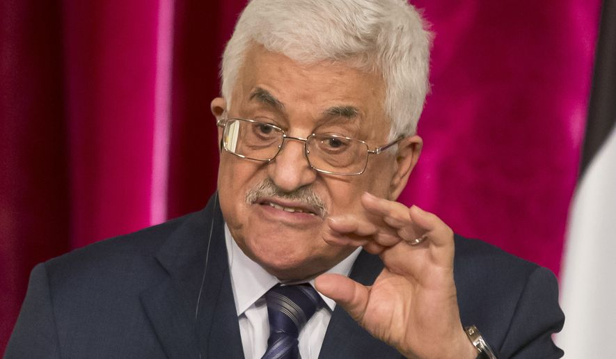"FILE -- In this Sept. 19, 2014 file photo, Palestinian President Mahmoud Abbas gestures as he speaks during a media conference at the Elysee Palace in Paris. The Palestinian president has been speaking in increasingly belligerent tones in recent weeks, accusing Israel of committing ""genocide"" in Gaza and calling on Palestinians to defend a contested Jerusalem holy site ""by any means."" The heightened rhetoric is a departure for the normally staid Abbas - and an apparent sign of desperation as he tries to halt a slide in popularity following this summer's war between Israel and the Islamic militant Hamas in Gaza. (AP Photo/Michel Euler, File)"