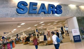 In this May 14, 2012 file photo, shoppers walk into Sears in Peabody, Mass. (AP Photo/Elise Amendola, File)