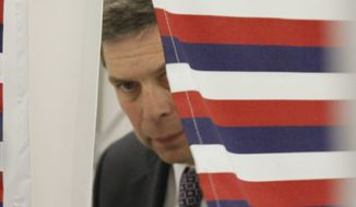 U.S. Sen. Mark Begich, D-Alaska, leaves the voting booth after casting his ballot at an early polling location on Monday, Oct. 20, 2014, in Anchorage, Alaska. Begich, a first-term incumbent, faces former Alaska Attorney General Dan Sullivan, a Republican, in the general election. (AP Photo/Mark Thiessen)