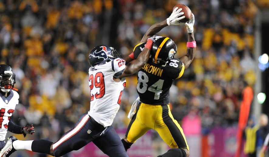 Pittsburgh Steelers wide receiver Antonio Brown (84) makes a catch past Houston Texans defensive back Andre Hal (29) in the fourth quarter of the NFL football game, Monday, Oct. 20, 2014, in Pittsburgh. (AP Photo/Don Wright)