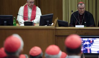 Pope Francis sits beside Vatican Secretary of State Cardinal Pietro Parolin as he leads a consistory expanded to include a briefing on the situation in the Middle East, at the Vatican, Monday, Oct. 20, 2014. (AP Photo/Max Rossi, Pool)