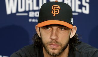 San Francisco Giants starting pitcher Madison Bumgarner talks to the media before baseball practice Monday, Oct. 20, 2014, in Kansas City, Mo. The Kansas City Royals will host the San Francisco Giants in Game 1 of the World Series on Oct. 21. (AP Photo/Orlin Wagner)