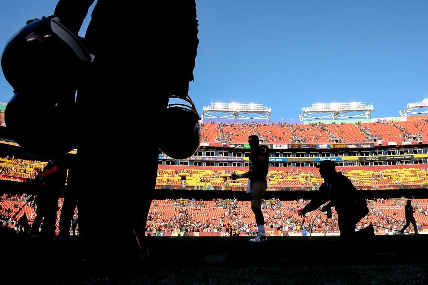 Washington Redskins quarterback Colt McCoy (16) is interviewed on the field after the Washington Redskins defeat the Tennessee Titans 19-17 at FedEx Field, Landover, Md., Sunday, October 19, 2014. (Andrew Harnik/The Washington Times)