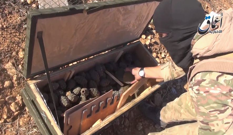 "War Loot: Islamic State militants rummage through a cache of weapons airdropped by U.S.-led coalition forces. The weapons were meant to supply Kurdish forces battling the extremist group in Kobani, Syria, but ""now they are spoils for the mujahedeen,"" one militant said. (Associated Press)"