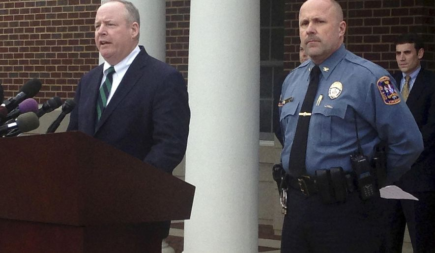 Fairfax County Commonwealth's Attorney Ray Morrogh, left, with Fairfax City Police Chief Carl Pardiny, speaks to reporters during a news conference in front of the Fairfax City Police station in Fairfax, Va., Monday, Oct. 20, 2014. The suspect in the disappearance of a University of Virginia student was charged Monday with abducting and raping a woman in suburban Washington, in 2005. The indictment against Jesse L. Matthew Jr. was handed up by a Circuit Court grand jury in Fairfax County and includes a charge of attempted capital murder, according to the indictment. Matthew, 32, is being held in Charlottesville, Va., on a charge related to the Sept. 13 disappearance of Hannah Graham, an 18-year-old from northern Virginia.  (AP Photo/Matthew Barakat)
