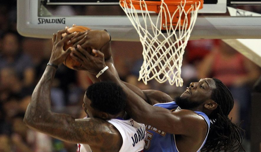 Los Angeles Clippers center DeAndre Jordan (6) and Denver Nuggets forward Kenneth Faried (35) reach for a rebound during the second half of an NBA preseason basketball game on Saturday, Oct. 18, 2014, in Las Vegas. The Nuggets defeated the Clippers 104-93. (AP Photo/Isaac Brekken)