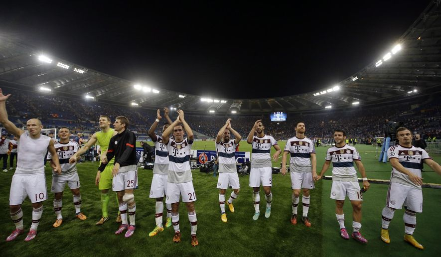 Bayern's players celebrate at the end of the Group E Champions League soccer match between Roma and Bayern Munich at the Olympic stadium, in Rome, Tuesday, Oct. 21, 2014. Bayern won 7-1. (AP Photo/Alessandra Tarantino)