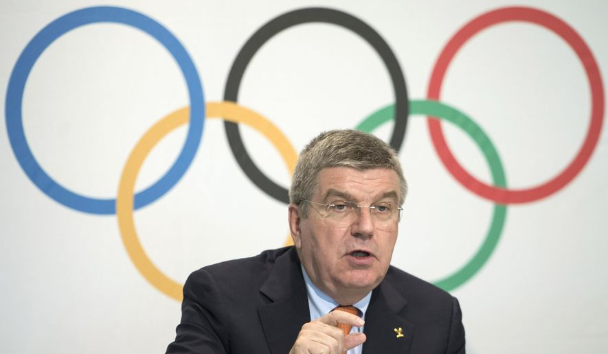 FILE - In this Wednesday, July 9, 2014 file photo, International Olympic Committee (IOC) President Thomas Bach speaks during a press conference after an executive board meeting at the IOC headquarters in Lausanne, Switzerland. IOC leaders gather in the Swiss lakeside town of Montreux this week to put the finishing touches on a package of reforms, including changes to the bidding process and sports program and creation of an Olympic television channel. (AP Photo/Keystone, Jean-Christophe Bott, File)