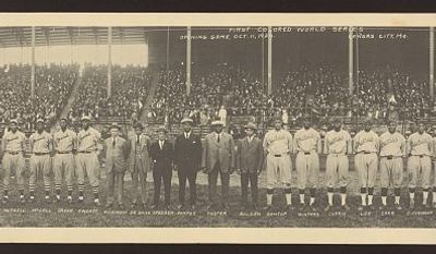 "Group portrait of players from the Kansas City Monarchs and the Hilldale Negro League baseball teams in front of grandstands filled with spectators before the opening game of the inaugural ""Colored World Series"" in 1924. (Photo by J.E. Miller via Library of Congress)"