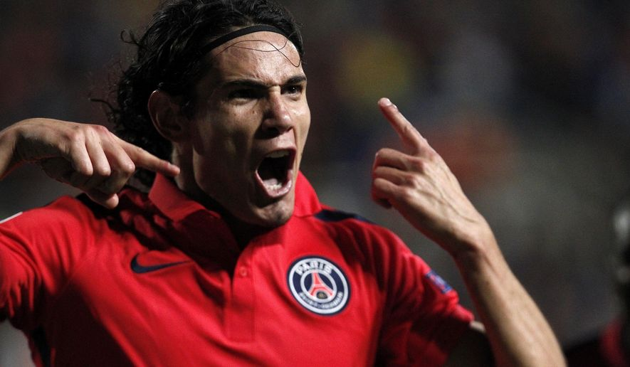 PSG's Edinson Cavani, celebrates after scoring against Apoel during the Champions League Group F soccer match between Apoel and Paris Saint Germain, at GSP stadium, Tuesday, Oct. 21, 2014. (AP Photo/Petros Karadjias)