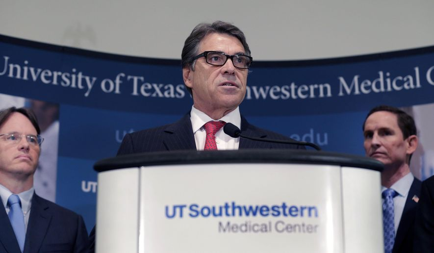 Texas Gov. Rick Perry speaks during a news conference at UT Southwestern Medical Center in Dallas, Tuesday, Oct. 21, 2014. Perry announced a North Texas Ebola treatment and infectious disease bio containment facility to be hosted at the Methodist Campus for Continuing Care in Richardson, Texas. Looking on are Dallas County Judge Clay Jenkins right and Commissioner of the Texas Department of State Health Services Dr. David L. Lakey. (AP Photo/LM Otero)