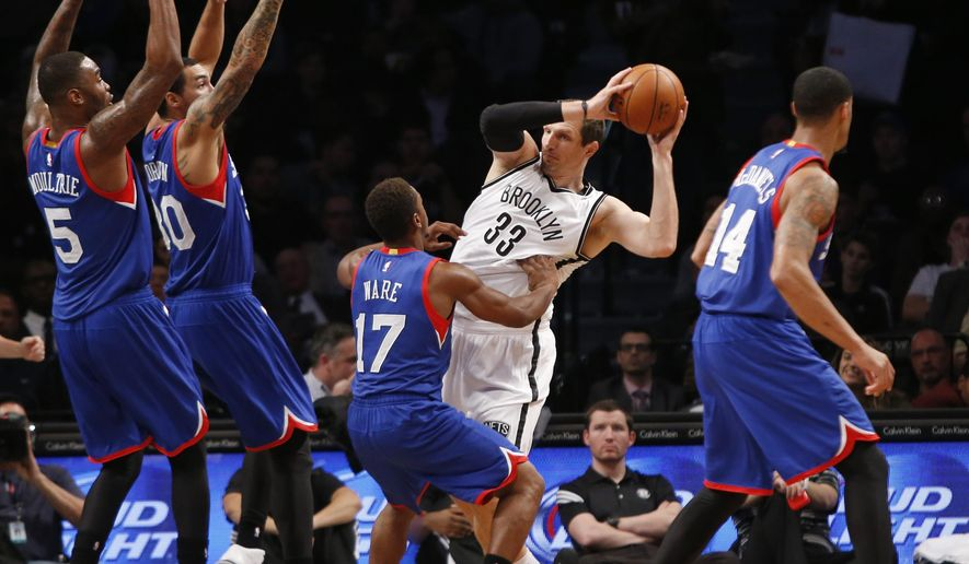 Philadelphia 76ers guard Casper Ware (17) defends Brooklyn Nets forward Mirza Teletovic (33) in the first of an NBA basketball game at the Barclays Center, Monday, Oct. 20, 2014, in New York. (AP Photo/Kathy Willens)