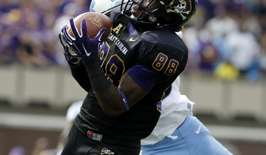 IFLE - In this Sept. 20, 2014, file photo, East Carolina wide receiver Trevon Brown (88) pulls in a 55-yard touchdown reception in front of North Carolina's Dominique Green (26) during the first half of their NCAA college football game at Dowdy-Ficklen Stadium in Greenville, N.C. The development of young receivers has given ECU more options in the passing game. (AP Photo/The News & Observer, Ethan Hyman, File) MANDATORY CREDIT