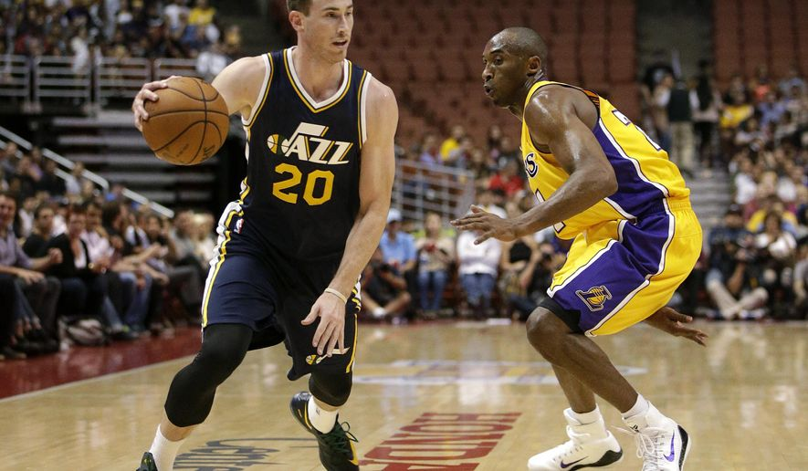 Utah Jazz's Gordon Hayward, left, drives against Los Angeles Lakers' Kobe Bryant during the first half of a preseason NBA basketball game Thursday, Oct. 16, 2014, in Anaheim, Calif. The Jazz won 119-86. (AP Photo/Jae C. Hong)