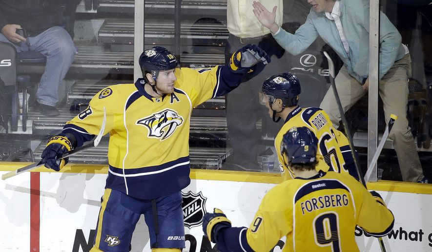 Nashville Predators left wing James Neal (18) celebrates with Mike Ribeiro (63) and Filip Forsberg (9), of Sweden, after scoring a goal against the Arizona Coyotes in the third period of an NHL hockey game Tuesday, Oct. 21, 2014, in Nashville, Tenn. (AP Photo/Mark Humphrey)