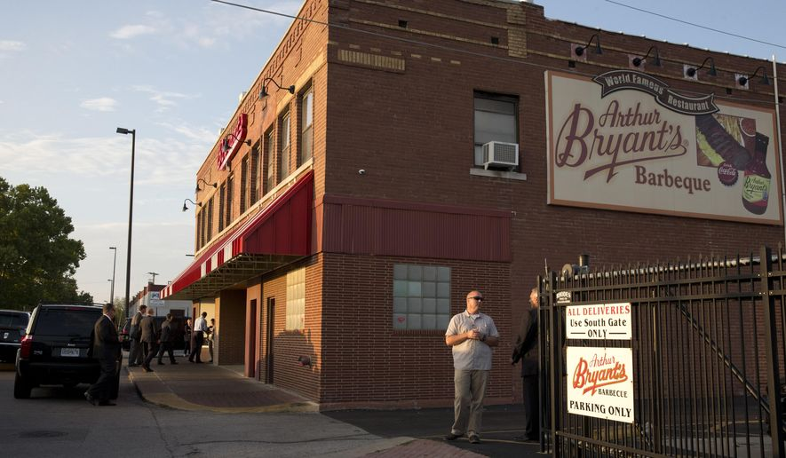 FILE - This July 29, 2014 photo shows Arthur Bryant's, the legendary barbecue restaurant in Kansas City, Mo., on the day President Barack Obama visited. Bryant's is a must-stop for politicians, having hosted everyone from Harry Truman to Jimmy Carter to Sarah Palin and John McCain. Bryant's is considered the grandfather of barbecue in Kansas City and has been at its current location since 1958, with roots going back to the city's first barbecue stand in the early 20th century. (AP Photo/Jacquelyn Martin, File)