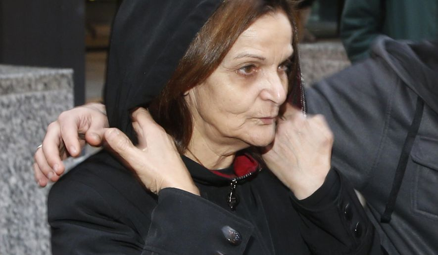 FILE - In this Oct. 22, 2013, file photo, Rasmieh Yousef Odeh stands outside the federal courthouse in Chicago. She is charged with immigration fraud, accused of lying to U.S. immigration officials when she failed to disclose her conviction for a terrorist bombing at a Jerusalem supermarket in 1969 that killed two people. Lawyers for Odeh urged a judge Tuesday, Oct. 21, 2014, to bar any reference to terrorism at her upcoming trial on immigration charges. Odeh's trial is set for Nov. 4. If convicted, she would lose U.S. citizenship and likely be deported. (AP Photo/Charles Rex Arbogast, File)