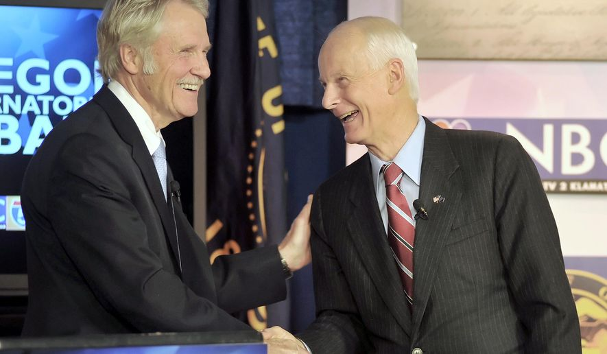 Gov. John Kitzhaber, left, and Rep. Dennis Richardson shake hands after a Gubernatorial Debate Monday, Oct. 20, 2014, at NBC5 in Medford, Ore. (AP Photo/The Medford Mail Tribune, Julia Moore)