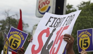 FILE - In this Sept. 14, 2014 file photo,  protesters participate in a rally outside a Burger King on Chicago's south side as labor organizers escalate their campaign raise the minimum wage for employees to $15 an hour. As Democrats across the country make an election-year push to raise the minimum wage, they are also looking to motivate younger people, minorities and others in their base to go to the polls on Nov. 4th. The party has put questions on the ballot in five states asking voters whether the minimum wage should be increased. (AP Photo/M. Spencer Green, File) **FILE**