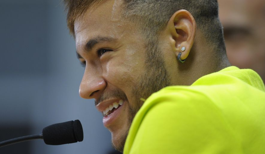FC Barcelona's Neymar from Brazil laughs during a press conference at the Sports Center FC Barcelona Joan Gamper in San Joan Despi, Spain, Monday, Oct. 20, 2014. FC Barcelona will play against Ajax in a group F Champions League on Tuesday Oct. 21. (AP Photo/Manu Fernandez)