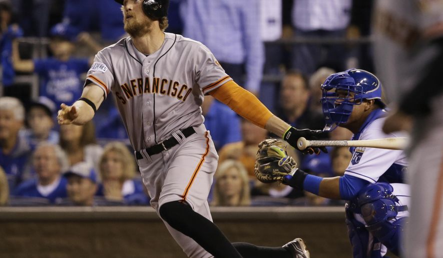San Francisco Giants right fielder Hunter Pence watches his two-run home run during the first inning of Game 1 of baseball's World Series Tuesday, Oct. 21, 2014, in Kansas City, Mo. (AP Photo/Charlie Neibergall)