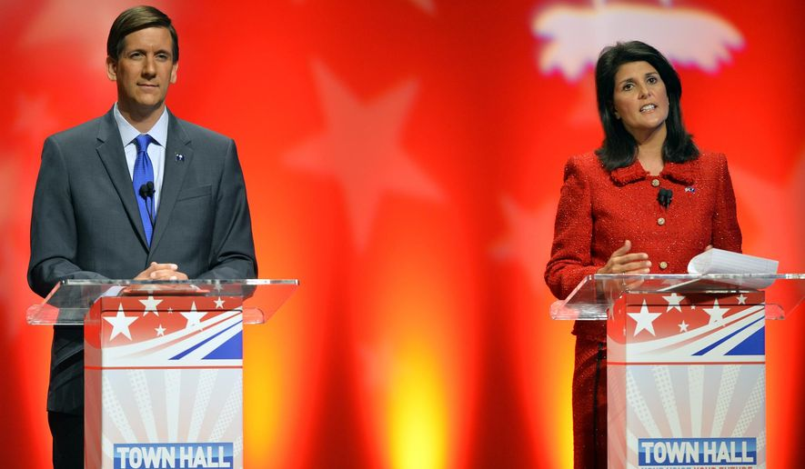 Democratic Sen. Vincent Sheheen listens as Republican incumbent Gov. Nikki Haley talks during a gubernatorial debate at Furman University's McAlister Auditorium in Greenville, S.C., Tuesday, Oct. 21, 2014. (AP Photo/The Greenville News, Mykal McEldowney)