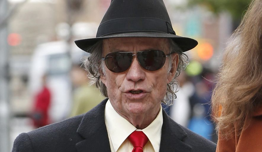 FILE - In this May 6, 2014 file photo, Texas entrepreneur Sam Wyly arrives to U.S. District Court in New York, for closing arguments in the civil trial of Wyly and his late brother Charles. Wyly on Sunday, Oct. 19, 2014 filed for bankruptcy protection as he and the estate of his brother face up to $400 million in penalties after being found liable for hiding stock holdings overseas. (AP Photo/Kathy Willens, File)