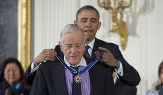 In this Nov. 20, 2013, file photo, President Barack Obama awards former Washington Post executive editor Ben Bradlee with the Presidential Medal of Freedom during a ceremony in the East Room of the White House in Washington. Bradlee died Tuesday, Oct. 21, 2014, according to The Washington Post. (AP Photo/ Evan Vucci, File)