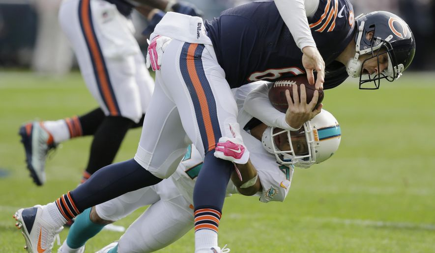 FILE - In this Oct. 19, 2014, file photo, Miami Dolphins cornerback Brent Grimes (21) tackles Chicago Bears quarterback Jay Cutler (6) during the second half of an NFL football game in Chicago. An analysis by Pro-Football-Reference.com shows Cutler's statistical performance at different stages of his career has mirrored quarterbacks as different as Johnny Unitas and Jake Plummer.(AP Photo/Nam Y. Huh, File)