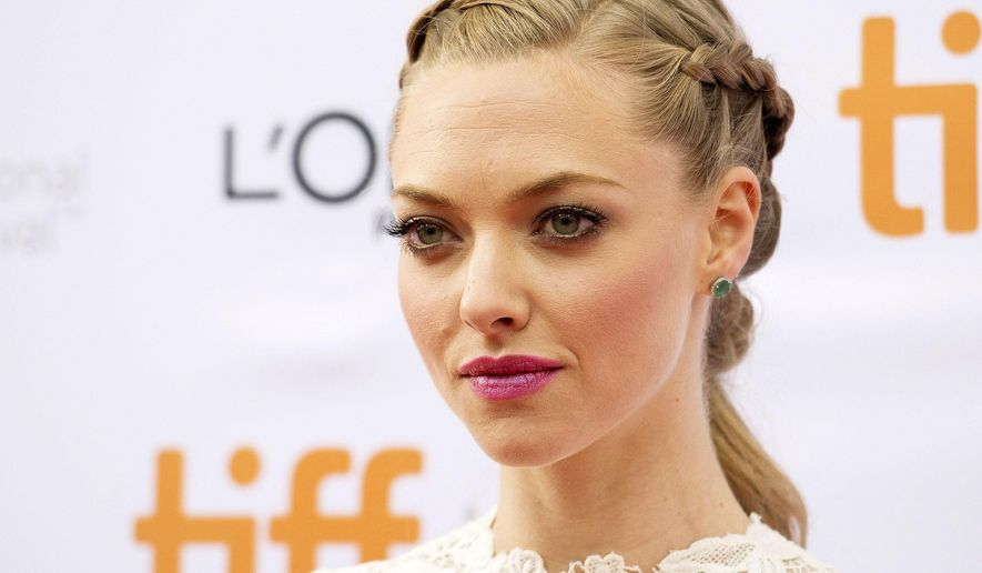 """FILE - In this Sept. 6, 2014 file photo, actress Amanda Seyfried poses for photographs on the red carpet for the new movie """"While We're Young"""" during the 2014 Toronto International Film Festival in Toronto. Seyfried, along with Melanie Griffith, Uzo Aduba, Peter Dinklage, Nina Dobrev and Pablo Schreiber will be appearing next month in the 14th annual benefit """"The 24 Hour Plays on Broadway,"""" which asks over a dozen actors, six writers and six directors to come up with six original short plays over the course of a day. (AP Photo/The Canadian Press, Nathan Denette, File)"""