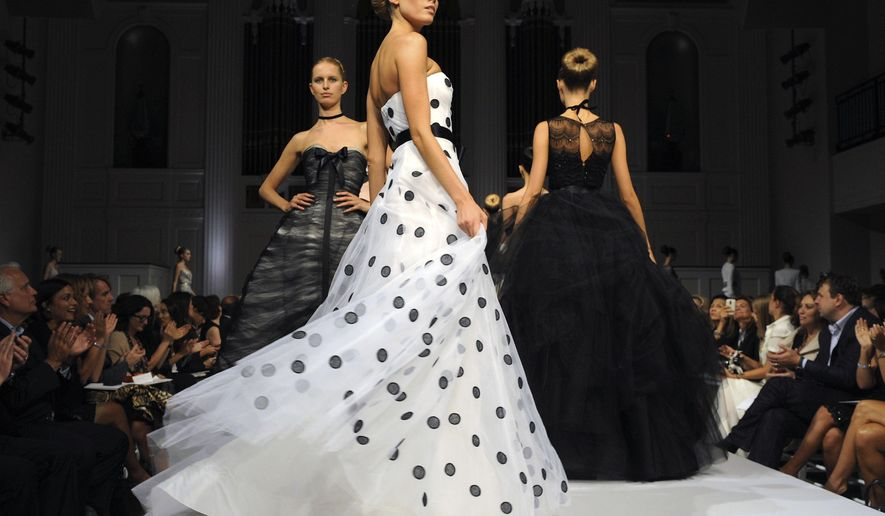 FILE - In this Sept. 16, 2010, file photo, the finale of the Oscar de la Renta spring 2011 collection is modeled during Fashion Week in New York. The designer, who died Monday, Oct. 20, 2014, at 82, shaped American couture half a century ago when it emerged as a serious rival to European fashion designers. (AP Photo/ Louis Lanzano, File)