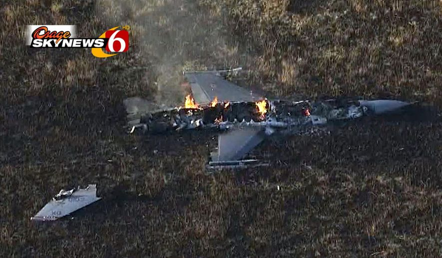 In this video frame grab provided by NewsOn6.com, the burning wreckage of an Oklahoma Air National Guard F-16 fighter jet is seen in a pasture about three miles northeast of Moline, Kan., Monday, Oct. 20, 2014. The pilot ejected and wasn't believed to be seriously injured, but was taken to McConnell Air Force Base in Wichita for evaluation, Col. Max Moss of the Oklahoma Guard said Monday. (AP Photo/NewsOn6.com)