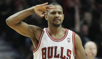 Chicago Bulls' John Lucas III (15) reacts after hitting a 3-point shot during the fourth quarter of an NBA basketball game against the Washington Wizards in Chicago on Wednesday, Jan. 11, 2012. The Bulls won 78-64. (AP Photo/Nam Y. Huh)