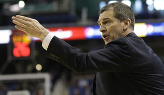Maryland head coach Mark Turgeon directs his team against Florida State during the first half of a second round NCAA college basketball game at the Atlantic Coast Conference tournament in Greensboro, N.C., Thursday, March 13, 2014. (AP Photo/Gerry Broome)