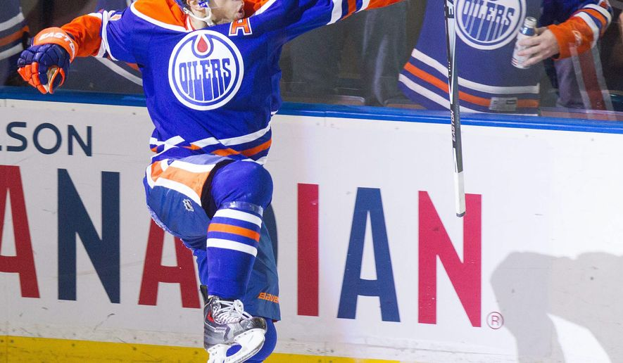 Edmonton Oilers forward Taylor Hall (4) celebrates his penalty shot goal against the Tampa Bay Lightning during second period NHL hockey action in Edmonton, Alberta, on Monday Oct. 20, 2014.(AP Photo/The Canadian Press,Amber Bracken)