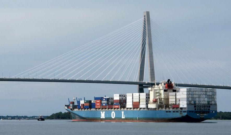 FILE - In this May, 21, 2013 file photo, a container ship moves through Charleston Harbor in Charleston, S.C. On Tuesday, Oct. 21, 2014 the U.S. Army Corps of Engineers holds a public meeting in Charleston on a half billion dollar plan to deepen the harbor shipping channel. The deeper channel will allow the port to handle bigger container ships. (AP Photo/Bruce Smith, file)