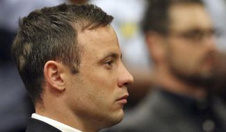 Oscar Pistorius sits in court in Pretoria, South Africa, Tuesday, Oct. 21, 2014. (AP Photo/Themba Hadebe, Pool)