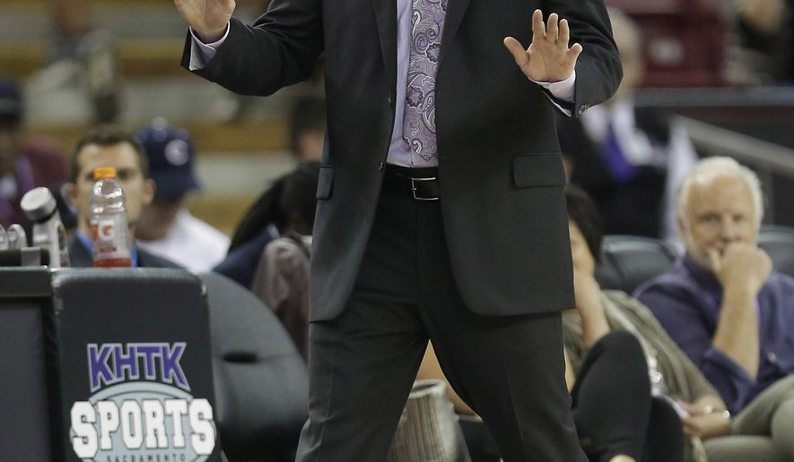 Sacramento Kings head coach calls out some instructions to his team during the fourth quarter of an NBA exhibition basketball game against Maccabi Haifa in Sacramento, Calif., Saturday, Oct. 18, 2014.  The Kings won 91-59.(AP Photo/Rich Pedroncelli)