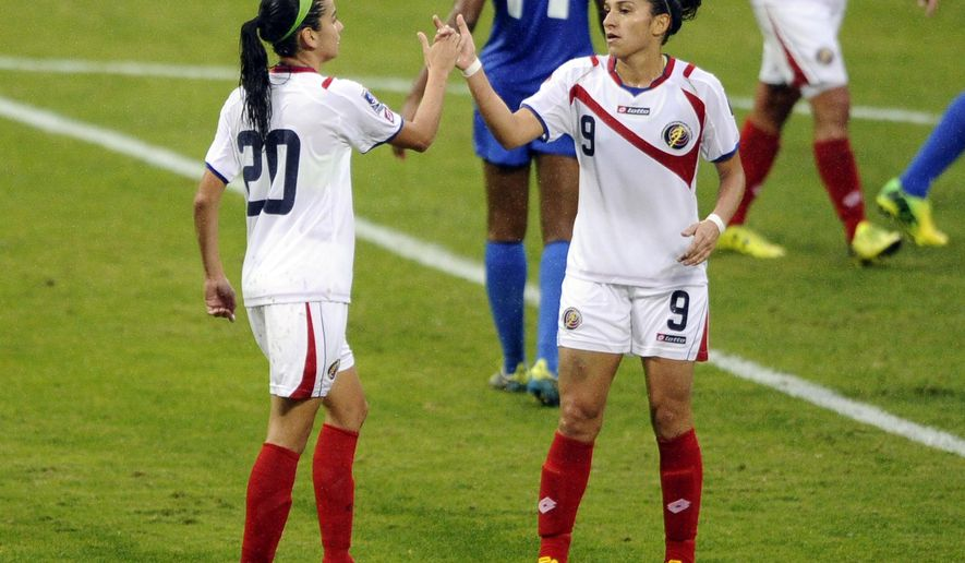 Costa Rica's Wendy Acosta (20) celebrates her goal with Carolina Venegas (9) during the first half of a CONCACAF soccer match against the Martinique, at RFK Stadium, Tuesday, Oct. 21, 2014, in Washington. (AP Photo/Nick Wass)