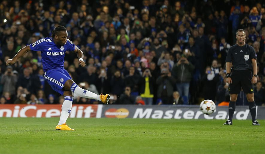 Chelsea's Didier Drogba scores a penalty during the Champions League Group G soccer match between Chelsea and NK Maribor at Stamford Bridge stadium in London Tuesday, Oct. 21, 2014. (AP Photo/Kirsty Wigglesworth)